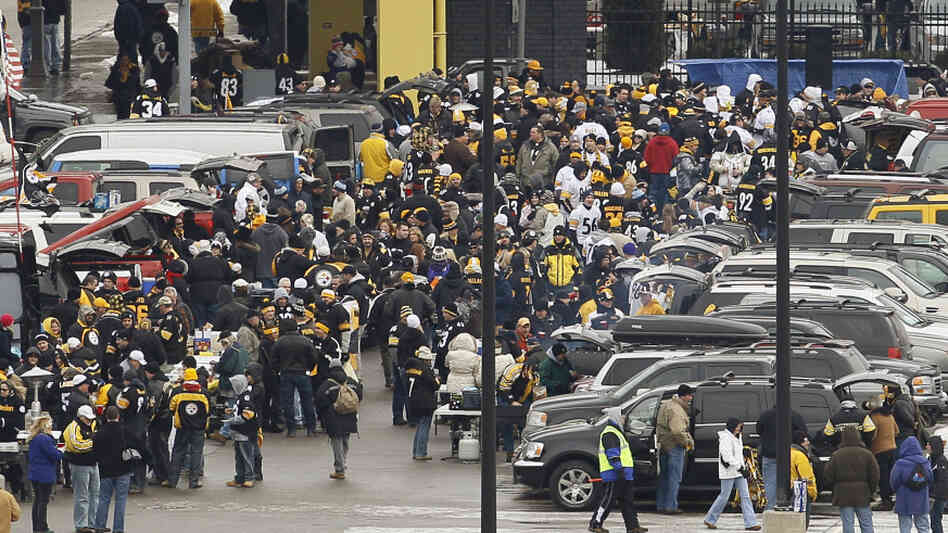 Fans tailgate outside Heinz Field in Pittsburgh before an NFL divisional playoff football game between the B