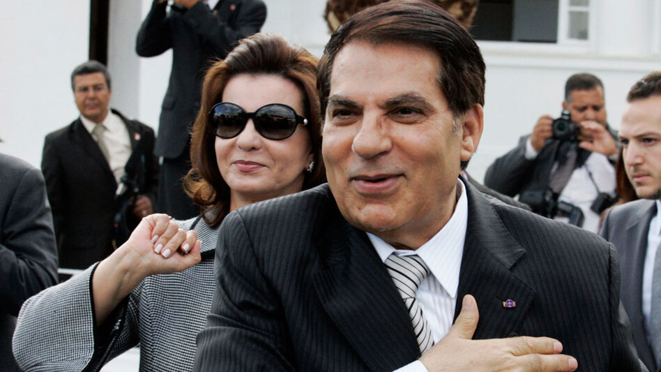 Then-Tunisian President Zine El Abidine Ben Ali and his wife,  Leila, salute their supporters in the affluent Carthage neighborhood next to the capital, Tunis, on Oct. 25, 2009.