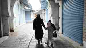 A woman and two children walk through the medina in Tunis on Tuesday.
