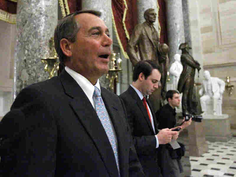 House Speaker John Boehner of Ohio walks through Statuary Hall on  Capitol Hill in Washington, Wednesday, Jan. 19, 2011, after the vote passed to repeal the health  care bill