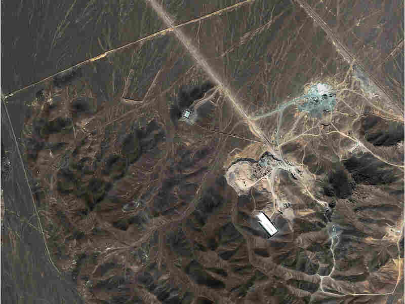 This  satellite image taken Sept. 27, 2009, shows a  suspected nuclear enrichment facility under construction inside a mountain  located about 20 miles north northeast of Qom, Iran. The revelation of the previously secret facility has fueled fears that Iran has a clandestine program to develop nuclear weapons.