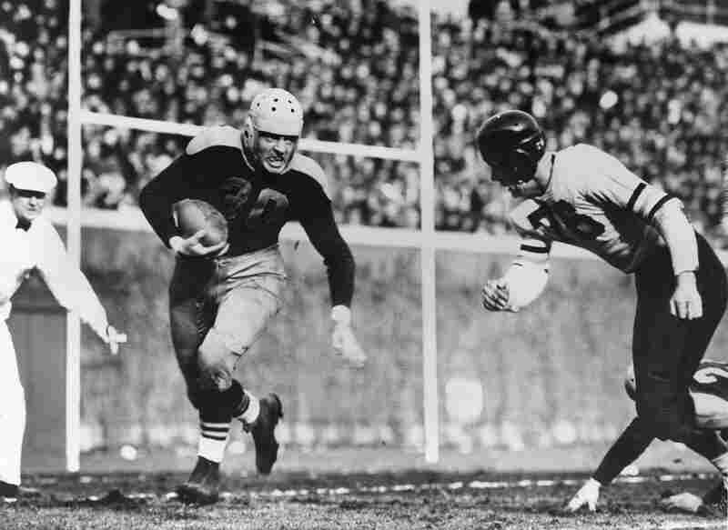 In the 1941 game, Green Bay Packers Hall of Fame running back Clarke Hinkle (left) tries to get past Chicago Bears defender Hampton Pool.