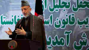 A special tribunal set up by Afghan President Hamid Karzai (shown here Jan. 4, 2011, in Kabul) has urged the president to delay the opening of Afghanistan's parliament, four months after the country's disputed elections.