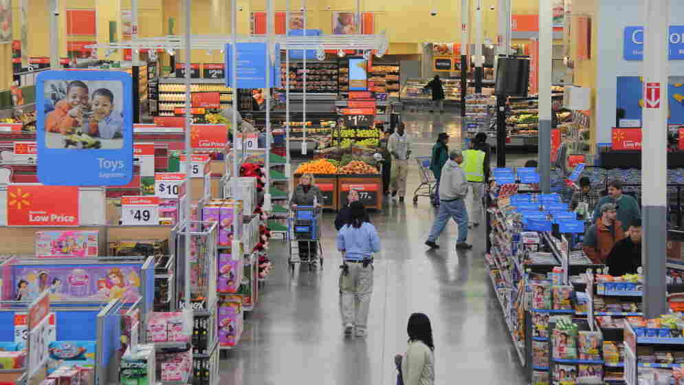 Groceries sit on shelves next to a variety of other goods at a Walmart in Fairfax County, Va. Analysts say Walmart's announcement Thursday about healthful foods may attract customers who buy not only groceries but other higher-margin goods.