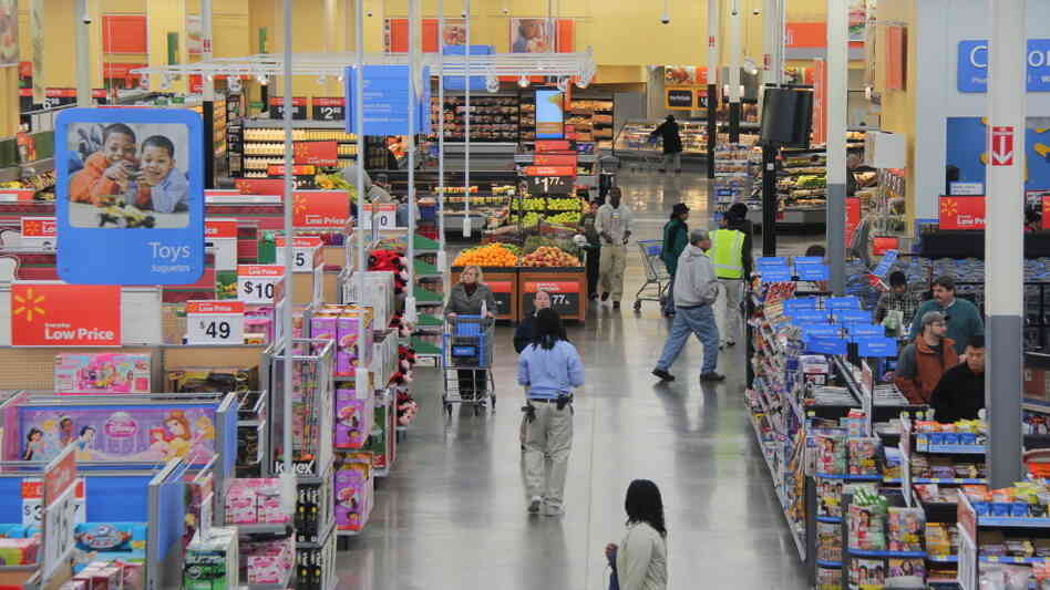 Groceries sit on shelves next to a variety of other goods at a Walmart in Fairfax County, Va. Analysts say Walmart's announcement Thursday about healthful foods may attract customers who