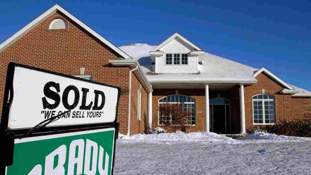"""A """"sold"""" sign in the front yard of a home in Springfield, Ill., last month."""