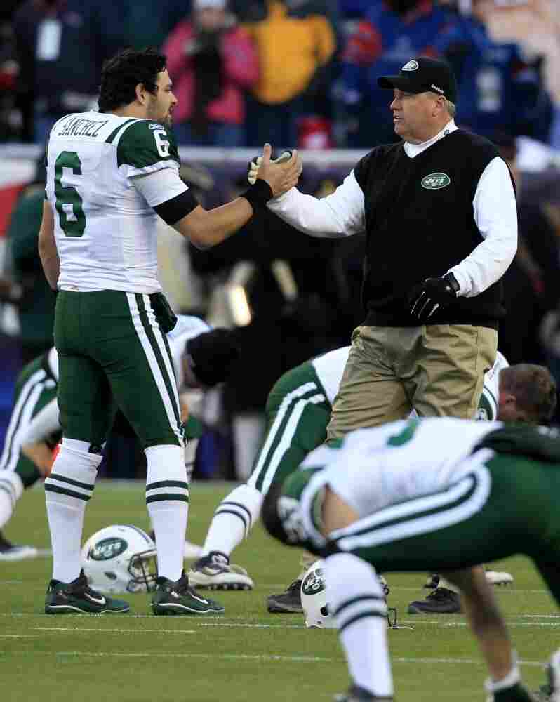 New York Jets quarterback Mark Sanchez and head coach Rex Ryan bond before last weekend's NFL playoff victory over the New England Patriots.