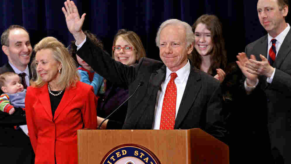 Surrounded by his family Wednesday in Stamford, Conn., Sen. Joseph Lieberman (I-CT) smiles as he announces that he has decided to retire and not seek a fifth term in 2012. From left: His wife, Hadassah, granddaughter Maddy Wisse, daughters Rebecca Lieberman-Wisse and Tennessee Lieberman, and son Matthew Lieberman.
