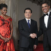 President Obama and first lady Michelle Obama greet Chinese President Hu Jintao at the state dinner at the White House on Wednesday. Hu's red carpet treatment in Washington this week underscores his country's status as the top U.S. economic rival.