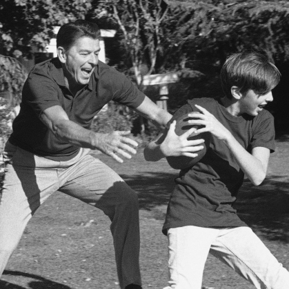 Ronald Reagan -- then governor of California -- and his son, Ron Reagan Jr., play touch football in the backyard of their Sacramento home in the fall of 1971.