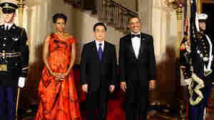 President Obama (right) Chinese President Hu Jintao (center) and first lady Michelle Obama arrive for the State Dinner at the White House in Washington, DC, on Wednesday (Jan. 19, 2011).