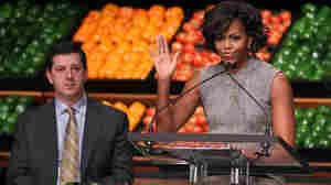 First lady Michelle Obama and Bill Simon, president and CEO of Wal-Mart's U.S. unit, at a media briefing on the company's food initiative held in Washington, D.C.