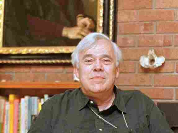 Author Reynolds Price poses in his Durham, N.C., home June 8, 1998. Price, the author of more than 30 books, died Thursday. He taught at Duke University for more than 50 years.