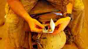 U.S. Marine Lance Cpl. Benjamin Buchanan from Jacksonville, N.C., looks at a picture his wife, Cassandra Buchanan, sent him in the mail as he sits on his cot at Camp Dwyer on July 1, 2009, in Helmand province, Afghanistan. Author Siobhan Fallon's collection of short stories explores the darker consequences of extended separation.