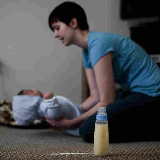 """Lindsey Ward dresses her 4-month-old son, Joshua, in her home in Woodbridge, Va., before making a """"milk run"""" to receive donated breast milk from another mother. Ward believes that breast milk has greater health benefits for her son than does formula, but she is unable to pump adequate amounts of breast milk for him."""