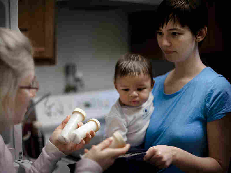 Ward picks up her donated breast milk  from fellow mother Natalie Erdossy in Reston, Va., on Jan. 12. Erdossy is one of more than eight nursing mothers who have donated milk to  Ward.