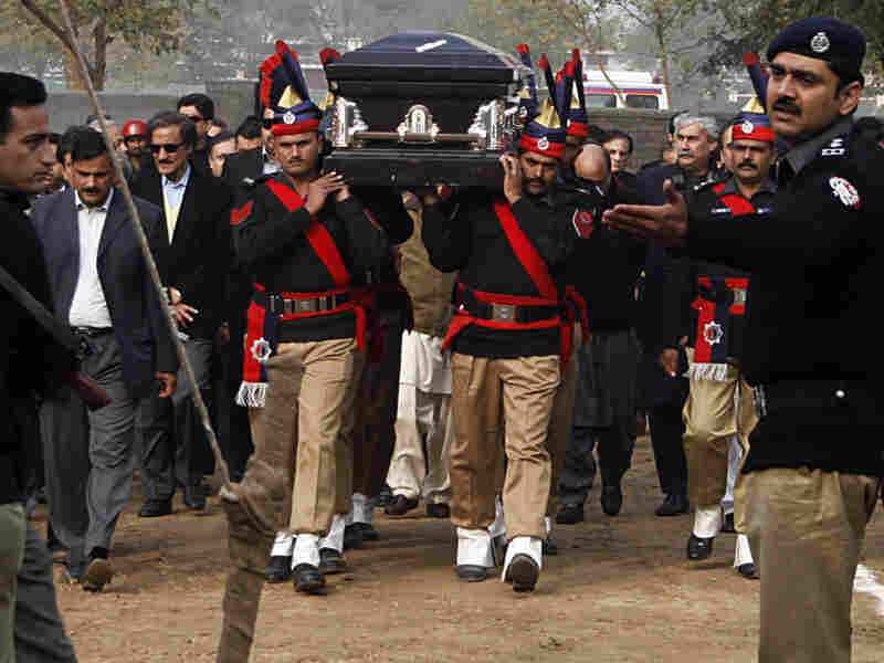Pakistani police guards carry the coffin of Punjab governor Salman Taseer, who was assassinated, during the funeral procession in Lahore on Jan. 5.