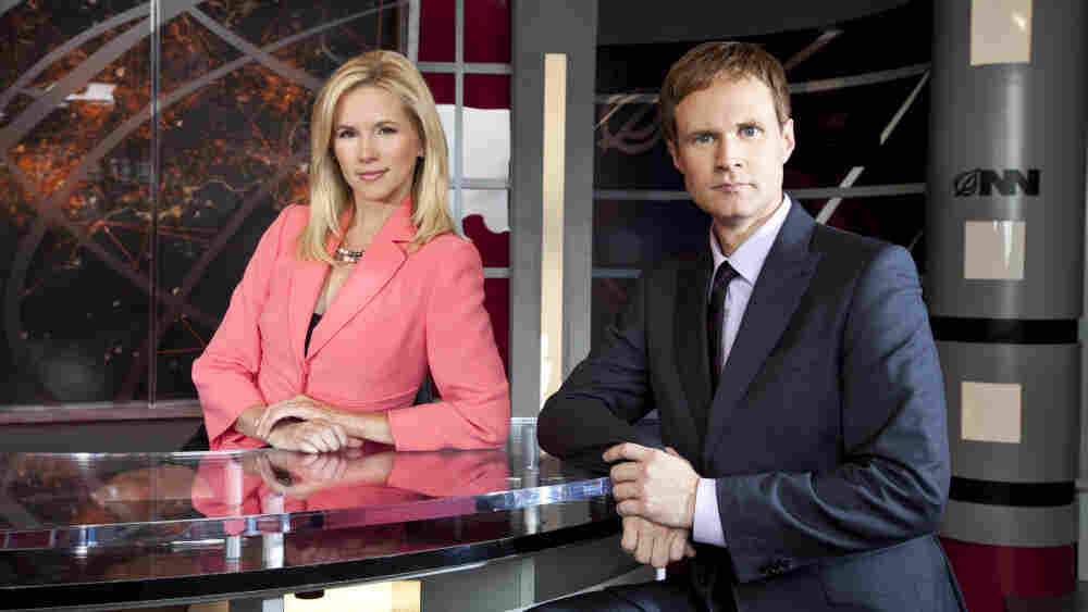 Suzanne Sena and Todd Alan Crain as anchors Brooke Alvarez and Tucker Hope on IFC's new Onion News Network.