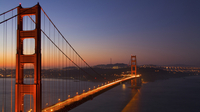 The rising sun sheds light on the Golden Gate Bridge in San Francisco.