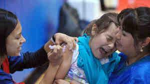 A student at Carlin Springs Elementary School receives a flu shot last January in Arlington, Va.