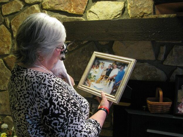Judy Jones Petersen, with a treasured photo of her family.