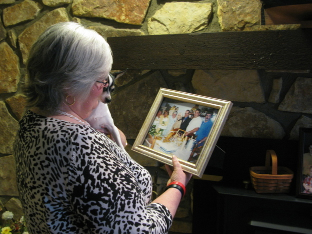 Judy Jones Petersen, with a treasured photo of her family. (NPR)