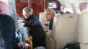 Gloria Giffords (center), Rep. Gabrielle Gifford's mother, talks with her daughter on the flight to Houston. Capt. Mark Kelly (far left), the representative's husband, talks with Tracy Culbert (center right), a nurse.