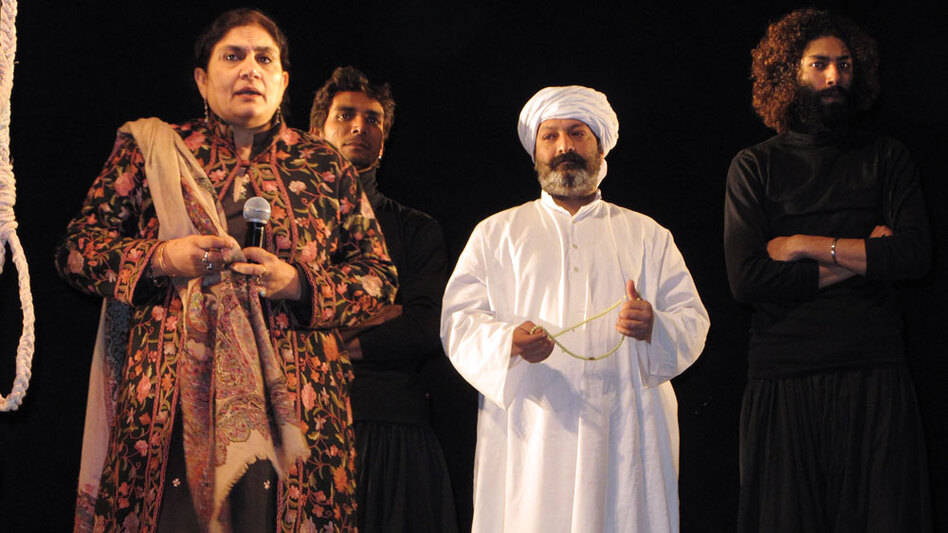 Ajoka Theater founder Madeeha Guahar on stage following a performance in Islamabad of a play about blasphemy. In the antisecular atmosphere following the Punjab governor's assassination, the staging of the play is a rare example of secular society standing up against the intimidation of religious extremists. (NPR)