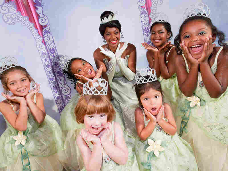 "An actress dressed as Princess Tiana of ""The Princess and the Frog,"" surrounded by young fans. Between 2000 and 2009, worldwide sales of ""Disney Princesses"" stuff, a special category of merchandising and marketing, went from $300 million to $4 billion, according to company executives."