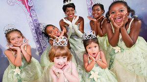 """An actress dressed as Princess Tiana of The Princess and the Frog, surrounded by young fans. Between 2000 and 2009, worldwide sales of """"Disney Princesses"""" stuff, a special category of merchandising and marketing, went from $300 million to $4 billion, according to company executives."""