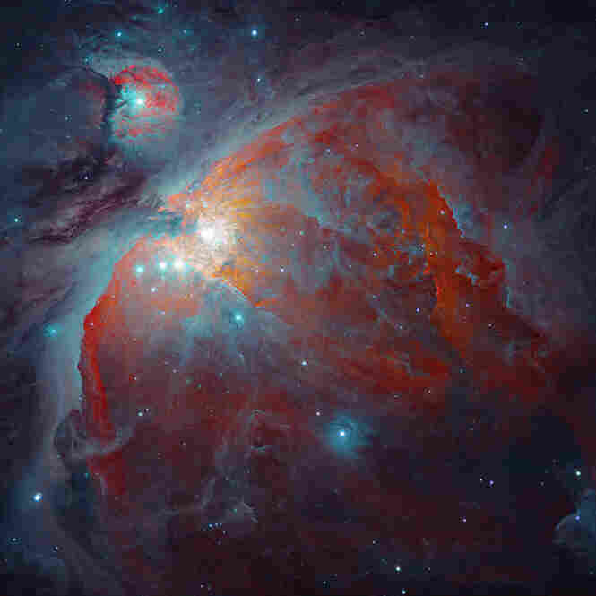 The Orion Nebula, or Messier 42, is a huge complex of gas and dust where massive stars are forming. It is the closest such region to Earth.