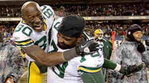 Donald Driver, Ryan Pickett celebrate the Packers' win.