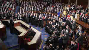 During past State of the Union addresses, the aisle clearly divided the two parties — as in this photo from President Obama's address last year, in which Democrats are standing and Republicans sitting.