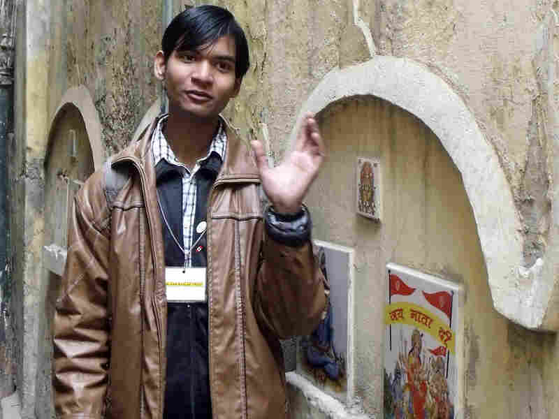 Satender Sharma, 18, is a former street kid who now, as a tour guide for the Salaam Baalak Trust, leads visitors through the narrow alleys where he  grew up in New Delhi.