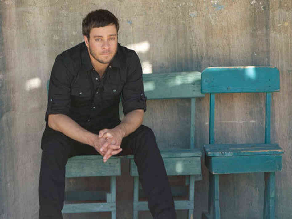 "On ""Mission Bell,"" Amos Lee keeps coming back to the idea that moving on means leaving things behind."