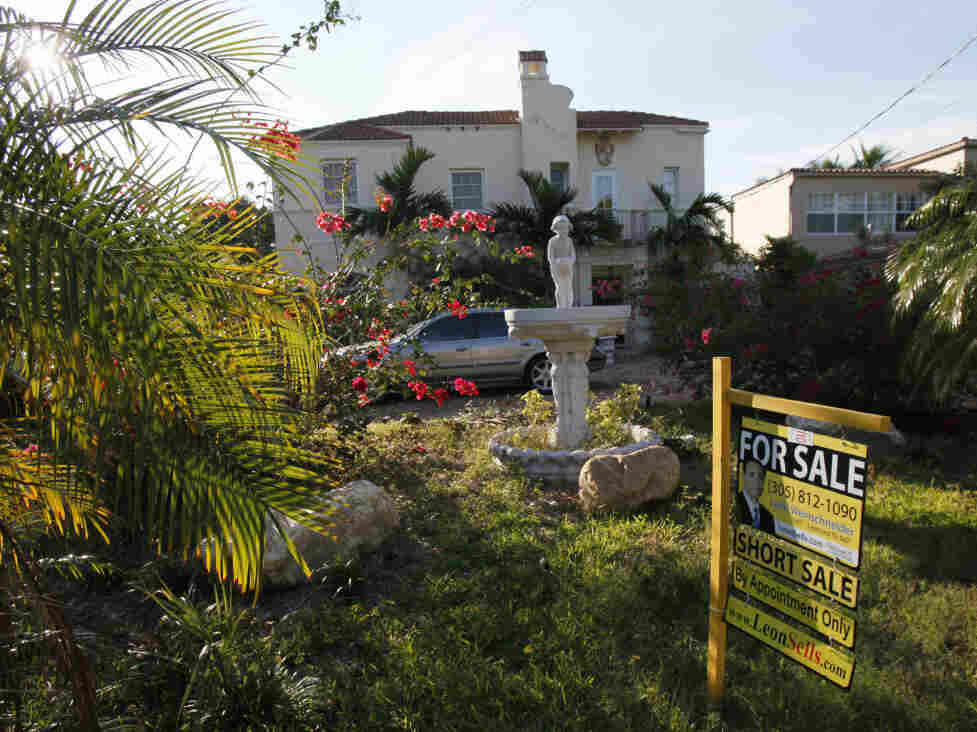 In this Jan. 20, 2010, a home is shown for sale, in Miami Beach, Fla. Sales of previously occupied homes took a large drop for the second straight month in January, falling to the lowest level since summer. It was another sign the housing market's recovery is faltering.(AP Photo/Wilfredo Lee)