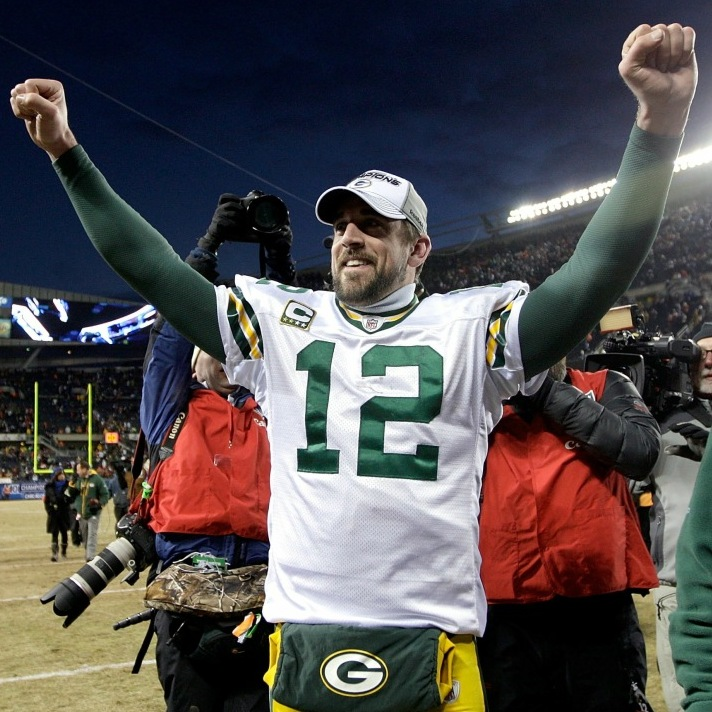 Quarterback Aaron Rodgers of the Green Bay Packers celebrates Sunday after his team's 21-14 victory against the Chicago Bears in the NFC Championship Game at Soldier Field  in Chicago, Illinois.