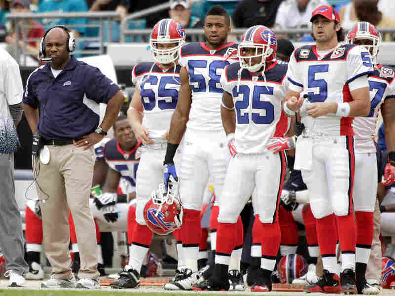 Head Coach Perry Fewell (L) of the Buffalo Bills watches his team play against the Jacksonville Jaguars in November  2009.