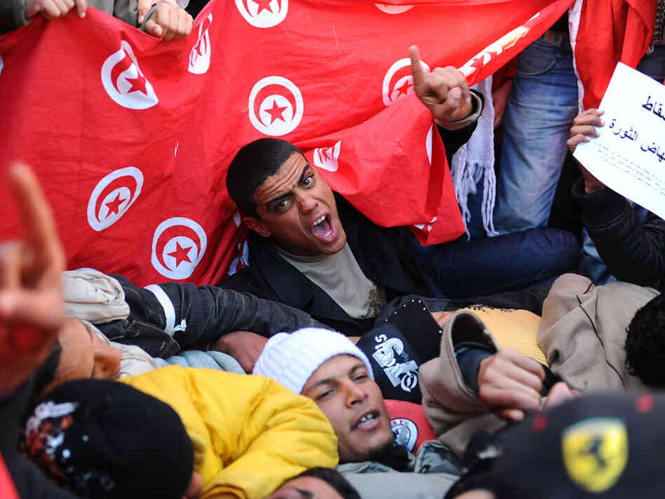 Inhabitants of the poverty-stricken central Tunisia region of Sidi Bouzid, chant slogans during a demonstration Sunday outside the government palace in Tunis.