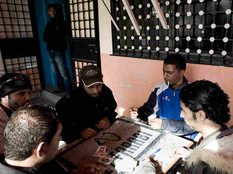 Young, unemployed men play cards in a cafe of Sidi Bouzid, the rural Tunisian town where a street vendor, Mohammed Bouazizi, set himself on fire, triggering recent protests.