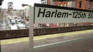 The view from the Metro North stop at 125th Street February 15, 2001 in New York City's Harlem neighborhood. Sharifa Rhodes-Pitts' new collection of essays reminisces on her experience moving to Harlem compared with that of the literary giants like Langston Hughes and Zora Neale Hurston who came before her.