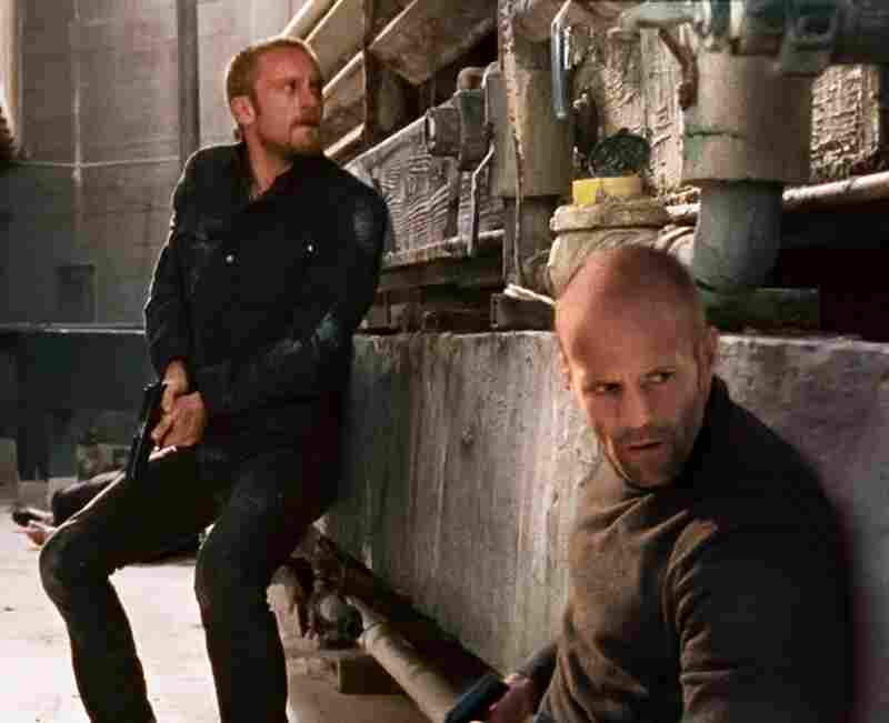 After discovering the truth about his mentor's murder, Arthur (Statham, foreground) takes on the man's troubled adult son (Ben Foster) as an  apprentice.
