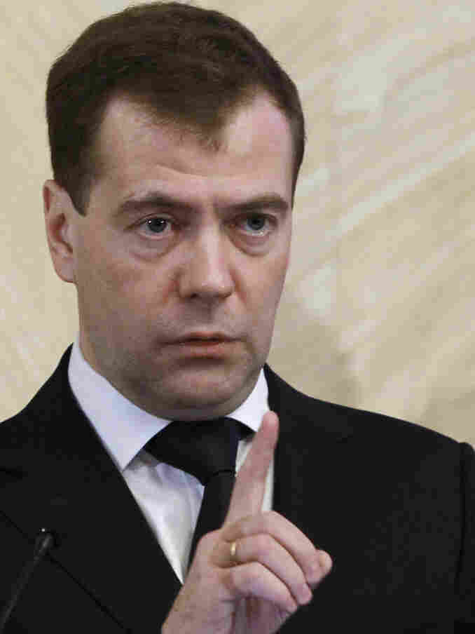 Russian President Dmitry Medvedev meets senior officers of the Federal Security Service in Moscow on Tuesday. He said Monday's explosion demonstrated that security regulations had been breached, and ordered authorities to beef up security at Moscow's  other airports and transport facilities.