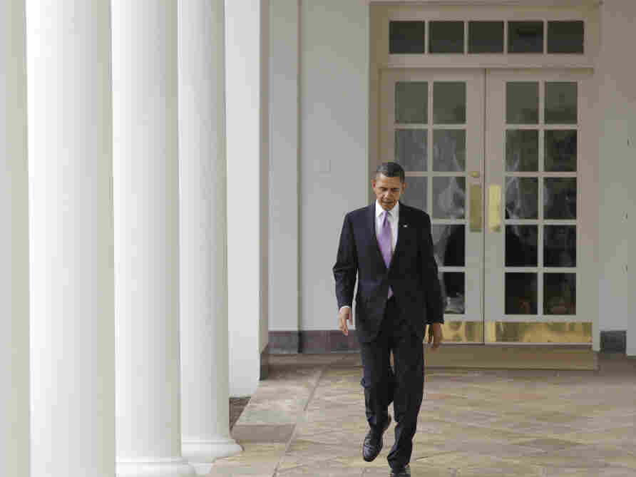 President Obama walks from the Oval Office along the White House Colonnade hours before his State of Union address.