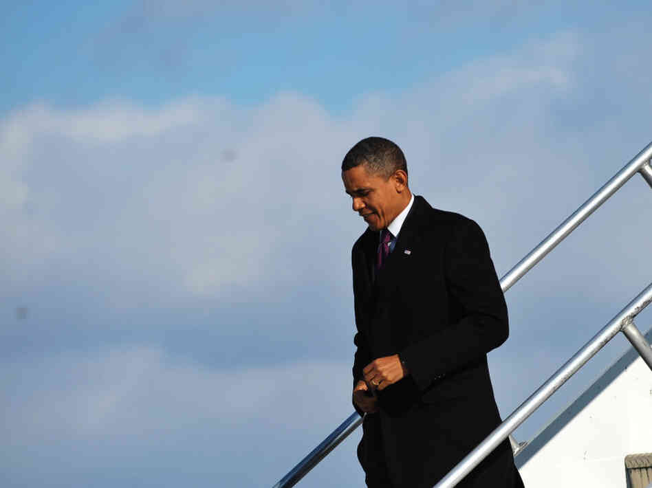 President Barack Obama steps off Air Force One upon arrival at Albany International Airport in New York. Obama will deliver the State of the Union address on Tuesday night, and many wonder what position he will take on Social Security.