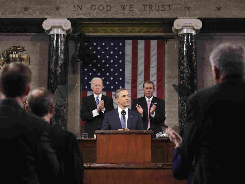 President Barack Obama delivers his State of the Union address on Capitol Hill on Tuesday. Vice President Joe Biden and House Speaker John Boehner of Ohio applaud at rear.