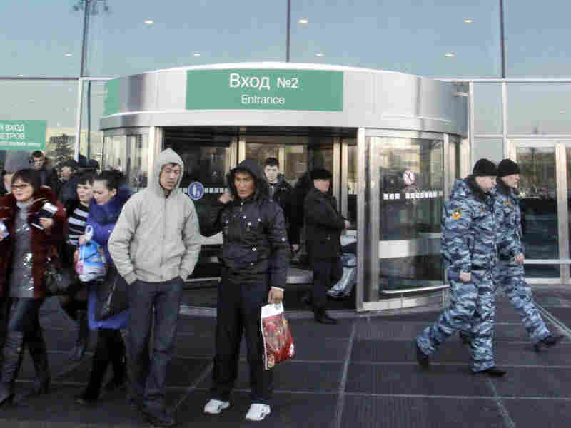 Russian security officers monitored an entrance to Domodedovo Airport on Tuesday.