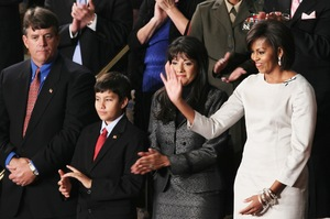 First lady Michelle Obama stands with John (from left), Dallas and Roxanna Green, the family of Arizona shooting victim Christina Green.