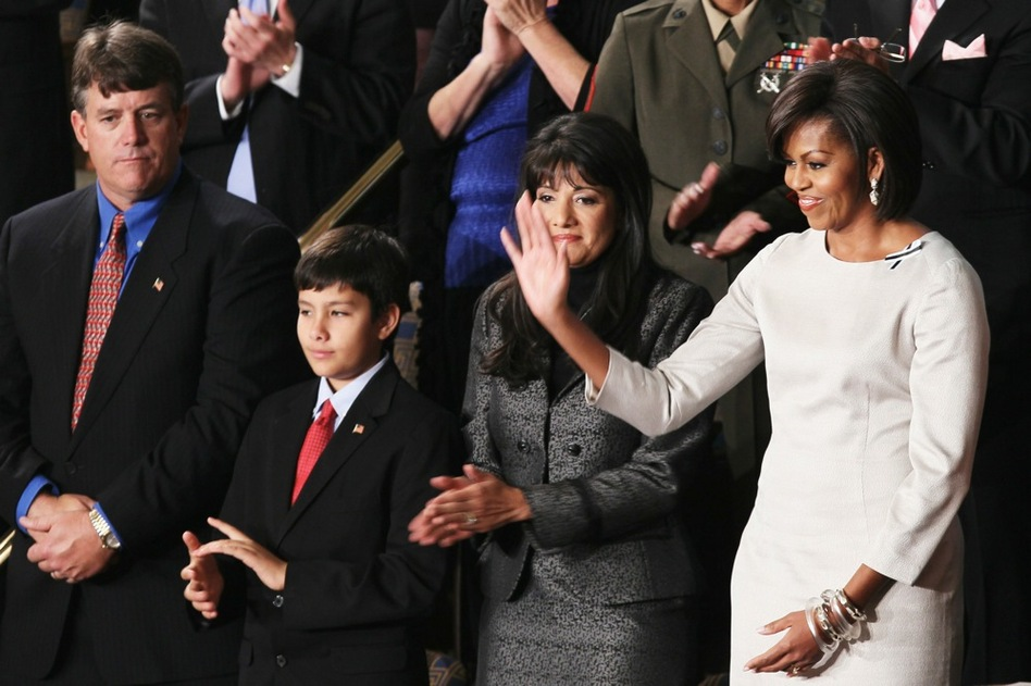 First lady Michelle Obama stands with John (from left), Dallas and Roxanna Green, the family of Arizona shooting victim Christina Green.  (Getty Images)