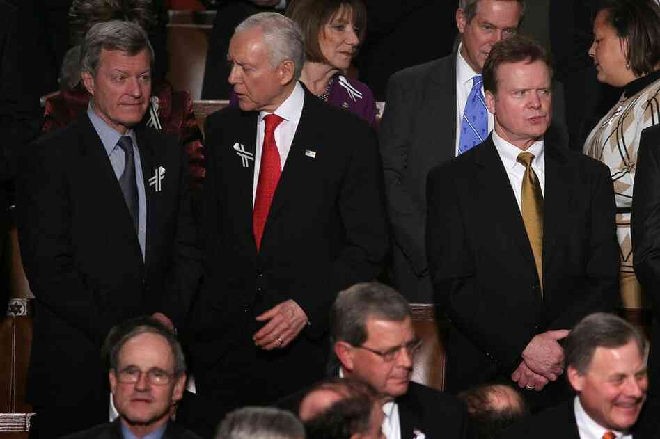 Montana Democratic Sen. Max Baucus (from left) talks with Sen. Orrin Hatch (R-UT) as Sen. Jim Webb (D-VA) looks on before the speech.